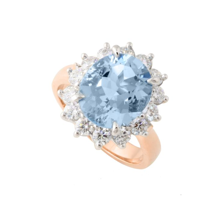 Amazing Aquamarine engagement ring with a halo of diamonds in 18ct rose gold.