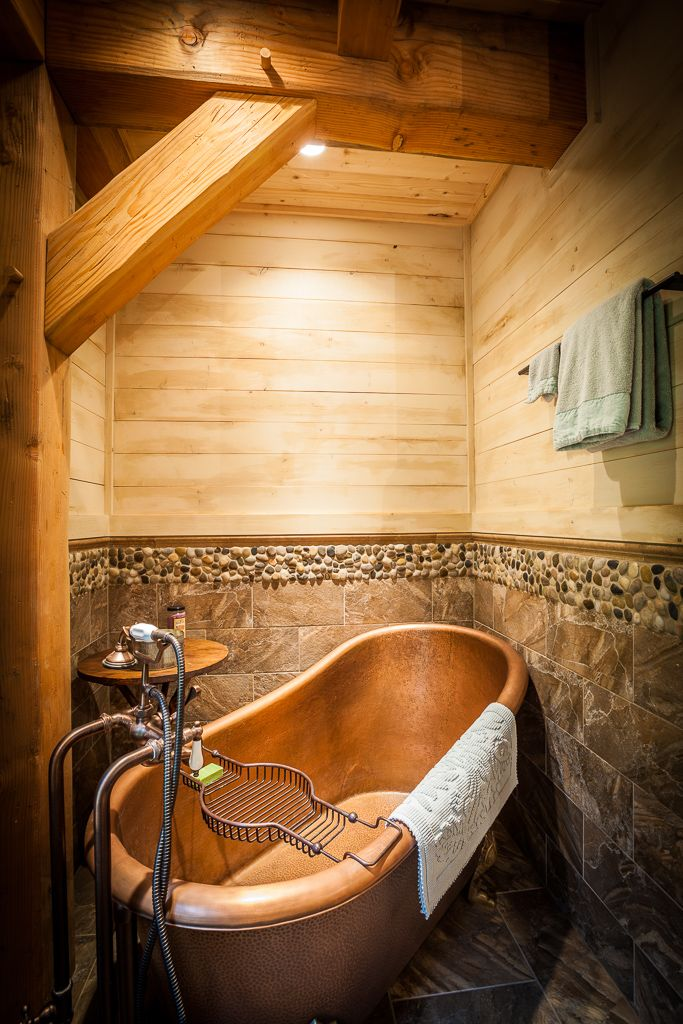 Natural Element Homes — Heavy timber in this gorgeous bathroom on the main...