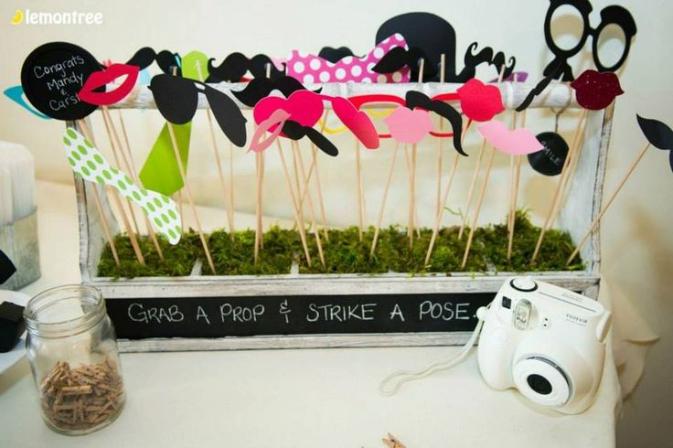 Props for the photo booth. We had the photos hung on a rustic board using tiny clothes pins to display throughout the night.