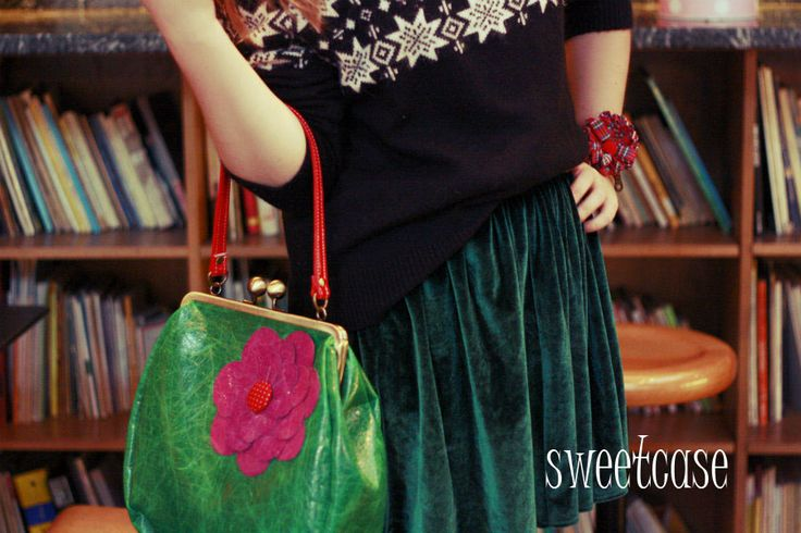 Leather bag and fabric cuff by Sweetcase.