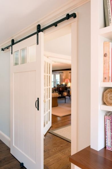 Sliding barn door to teeny tiny bathroom reduces wasted space in bathroom. Windows up top of door will let light in in a bathroom with no windows.