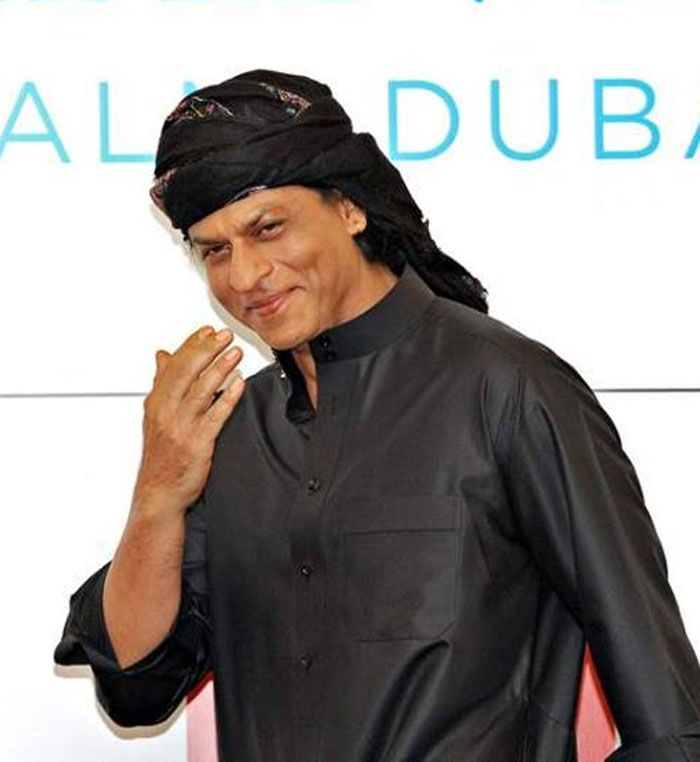 Shahrukh Khan greeting fans and the media as he arrives at a press conference in Dubai where he is filming Farah Khan's Happy New Year (scheduled for release Diwali 2014).  (This image was posted on Facebook by Bollywood's Biggest Fans Club - BBFC )