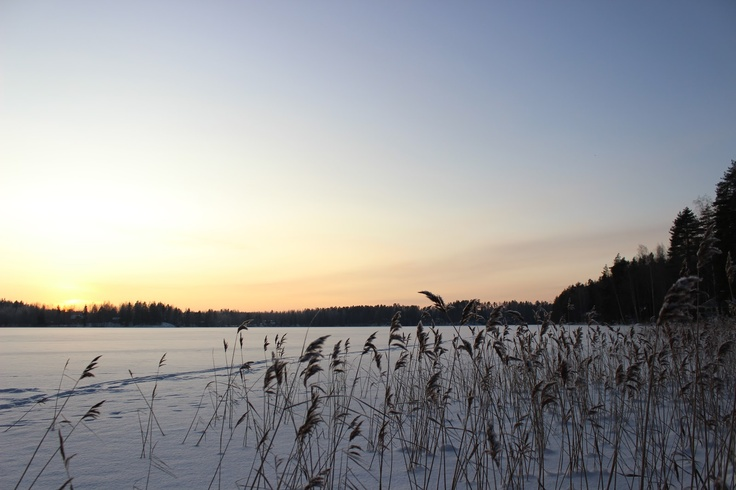 Sunset and a frozen lake in Finland