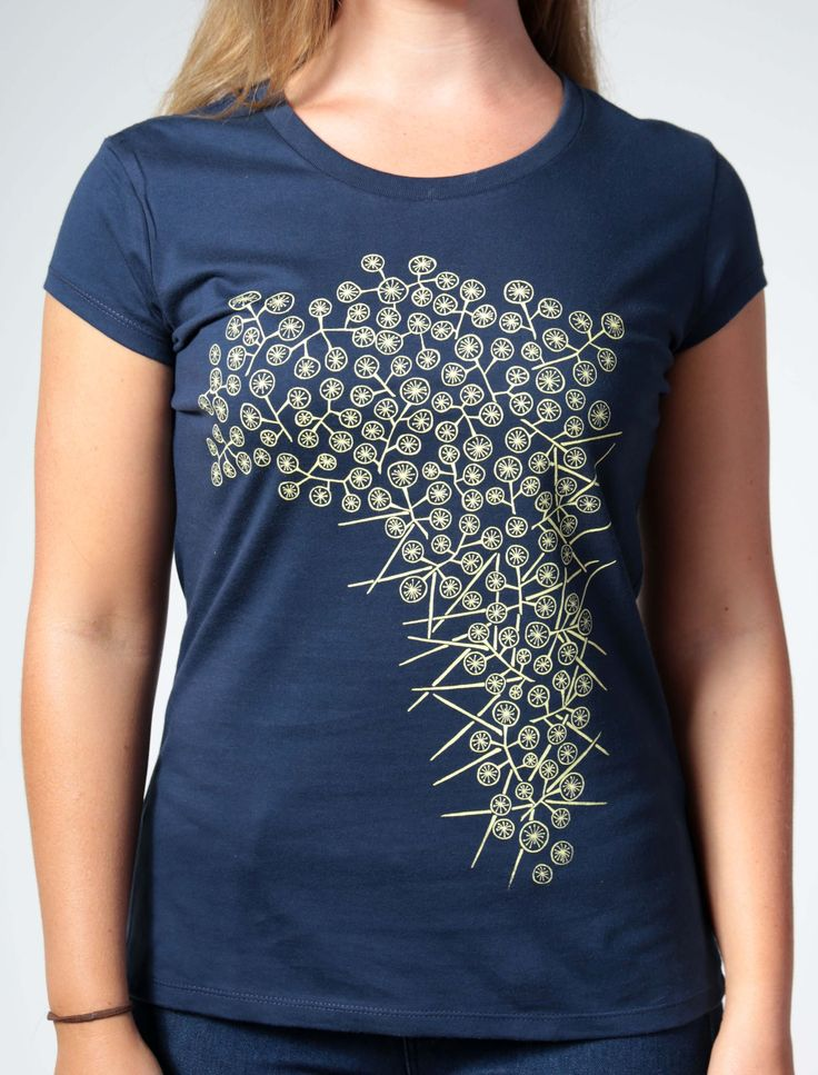 Originally developed for Sydney's Royal Botanic Gardens and now one of our most popular tee's. Our wattle design, Australia's floral emblem, now has its bright colours against a navy t-shirt.  Handprinted in golden yellow onto a navy organic cotton t-shir