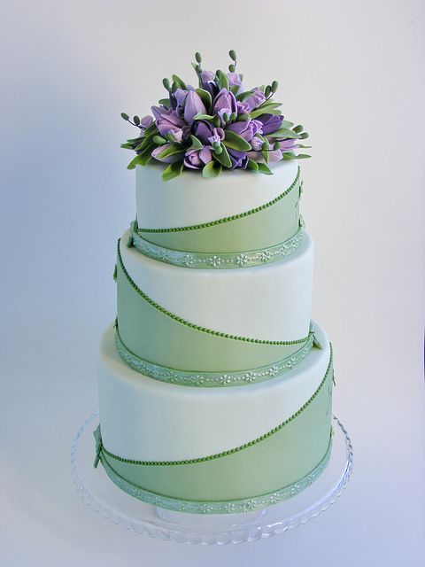 Green wedding cake with purple tulips by bubolinkata, via Flickr