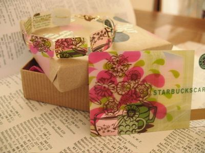 Gift card bracelet  This bracelet is made out of a Starbucks card. Cut the card into squares, then rounded them with a Corner Chomper. Punch holes in each piece with cropadile. String together using jewelry wire or jump rings.    Include a matching Starbucks gift card with the bracelet.