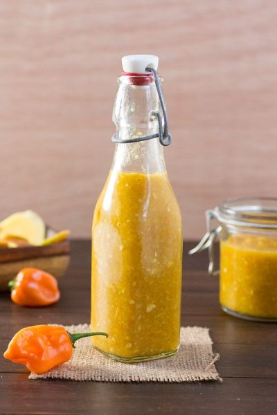 Homemade hot sauce! We're going Caribbean with this recipe, bringing in flaming habanero peppers, velvety mango, vinegar, honey, allspice and more. Drizzle it over chicken, shrimp or fish. Love it. It's a way of life.