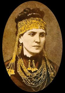 In 1873 Heinrich Schliemann (1822-1890) the amatuer archaeologist and excavator of Troy, discovered a spectacular hoard of 250 gold objects ..This is his wife with the jewelry found.