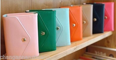 iPhone wristlet wallet... it's only $13... I need to remember to buy this