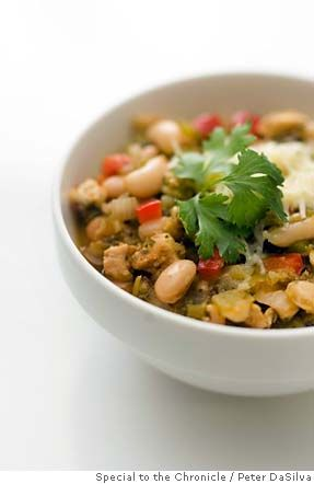 1995 white chilli  2 garlic cloves, minced  1 tablespoon crushed cumin seeds  2 cups grated sharp white cheddar cheese  Combine the tomatillos, cilantro, vinegar and salt in a food processor and process to a salsa consistency.  Add the drained cooked beans and simmer for 20 minutes.  Ladle a generous cup of ...