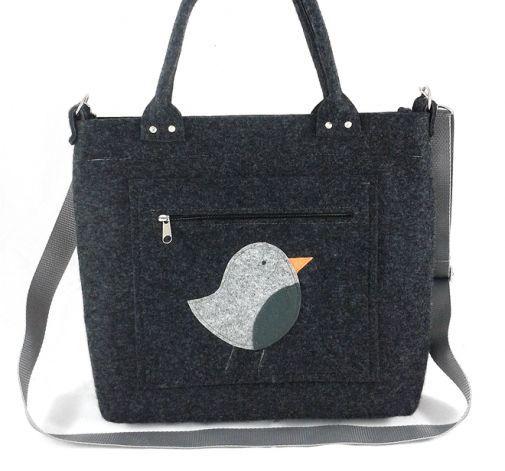 Gray bird on pocket/strap