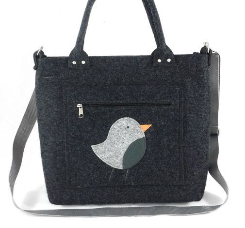Gray bird on pocket/strap