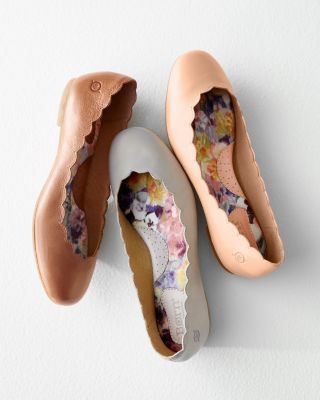 Raising the barre on graceful style and all-day comfort, these Italian-leather ballet flats are delicately adorned with an all-around petite-scallop trim, and feature B's signature hand-sewn construction, soft arch support, and leather-lined footbed. By B for Garnet HillRound toeLeather upperMoisture-wicking footbedRubber soleImported/Italy