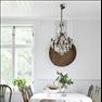 Runt matbordet står udda stolar från Överjärva antik i Solna. Kristallkronan är köpt i en antikaffär...