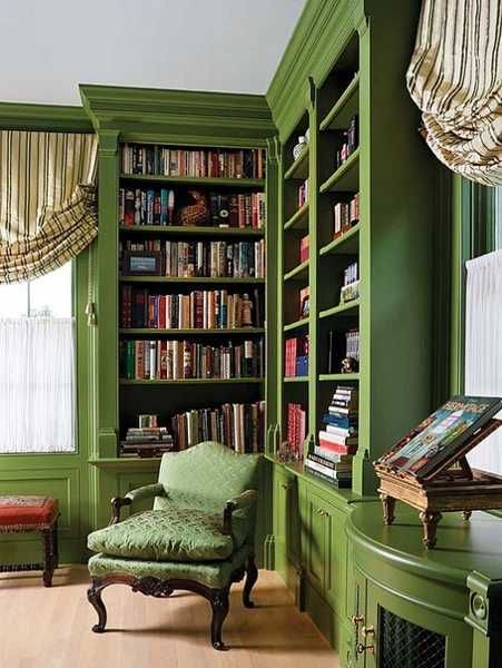 green bookcases and chair are so bold and interesting