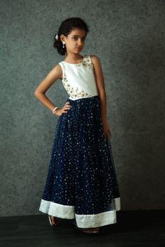 Net gown embellished with zari work from #Benzer #Benzerworld #ethnicwear #kidswear