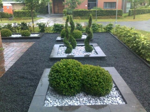 Create a rectangular plant bed in the front garden with an edge. Fill with slate