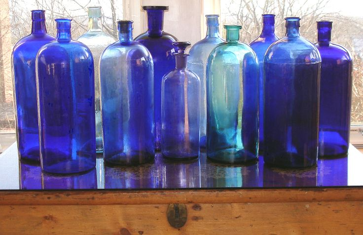 Vintage apothecary blue bottles featured on I Antique Online.com. Visit http://iantiqueonline.ning.com/