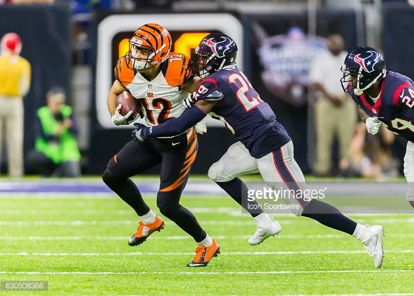 News Photo : Houston Texans free safety Andre Hal tackles...
