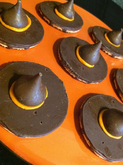 Upside down Keebler fudge stripe cookies, orange wilton tube frosting and a Hershey's kiss = Witch Hat cookies for Halloween