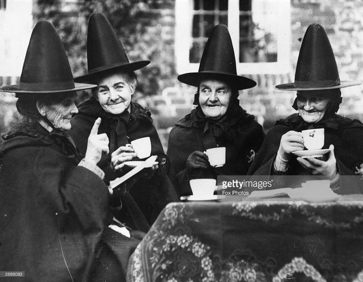 Four elderly women wearing Jacobean dress taking their afternoon tea at the Hospital of Holy and Undivided Trinity at Castle Rising, Norfolk. The Hospital was founded by Henry Howard, Earl of Northampton, in 1610 and provides for a governess and twelve sisters. It is a quiet retreat for quaintly garbed old ladies to spend the eventide of life.