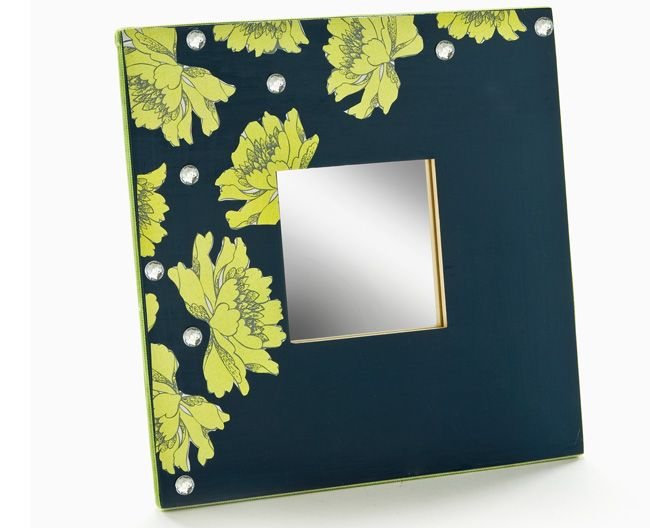 A delightfully DIY decoupage mirror! Learn how to make your own with Plaid products!
