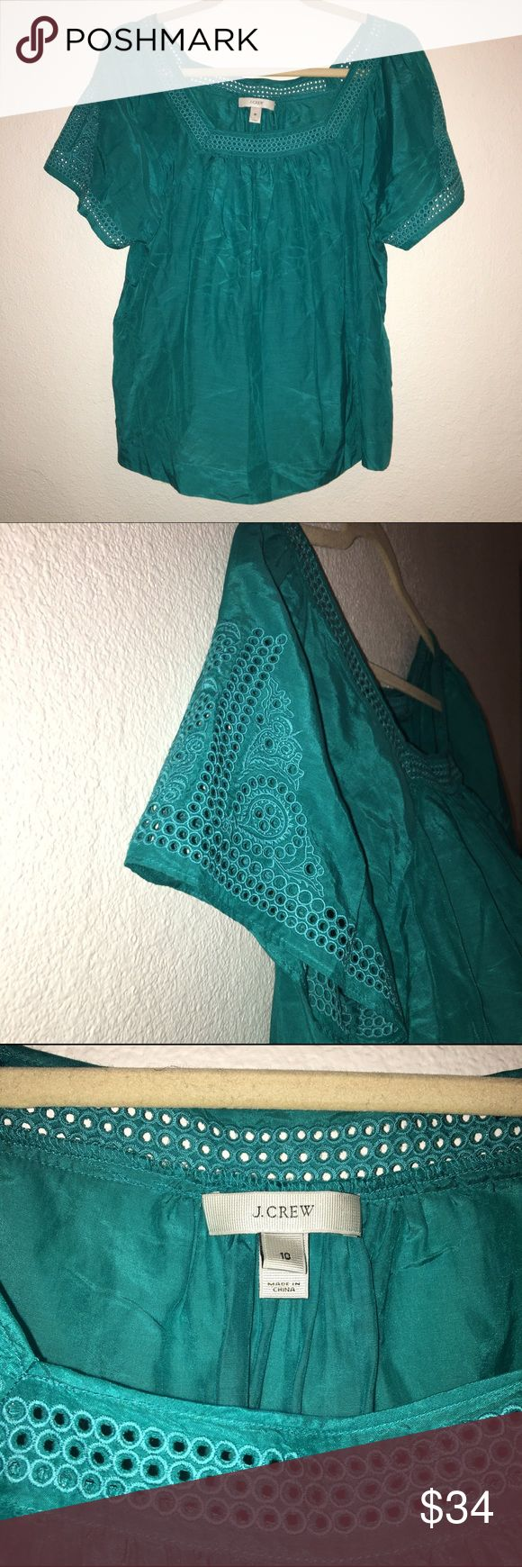 J CREW teal silk crochet short sleeve top worn once. silk blend. embroidered/crochet shoulder and neck. shiny teal/aqua color. J. Crew Tops Blouses