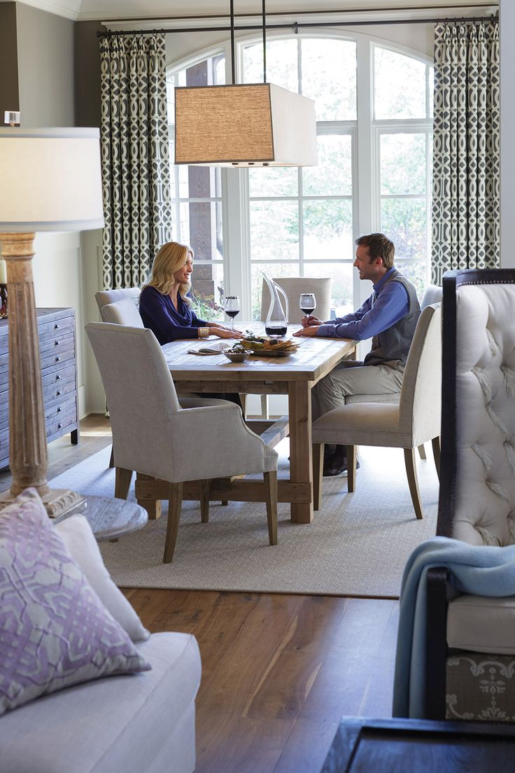 A Soft Area Rug Under The Dining Table Helps To Separate This Space From Living