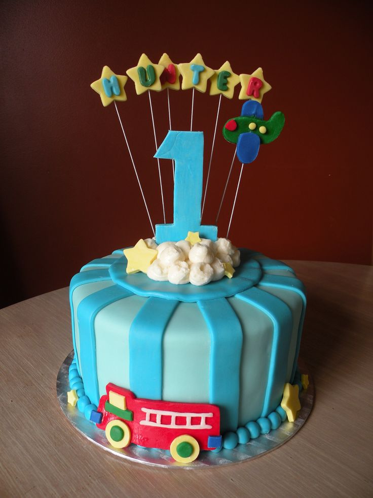 """Landyn's cake will look somewhat like this... it matches the """"Playtime"""" 1st birthday theme! His cake will be 2 layers instead of one!! Can't wait to see it!!!! :)"""