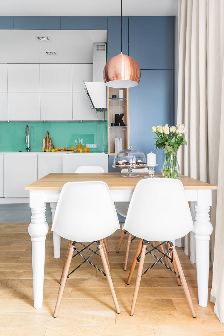 White kitchen with mint glass and blue-gray. Cozy dining area.