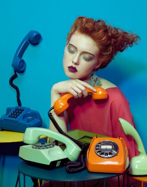 Vogue Italia photograph by Lucia Giacani. Red-head curls, woman with vintage telephones and aqua paint. Orange and blue look so good together.