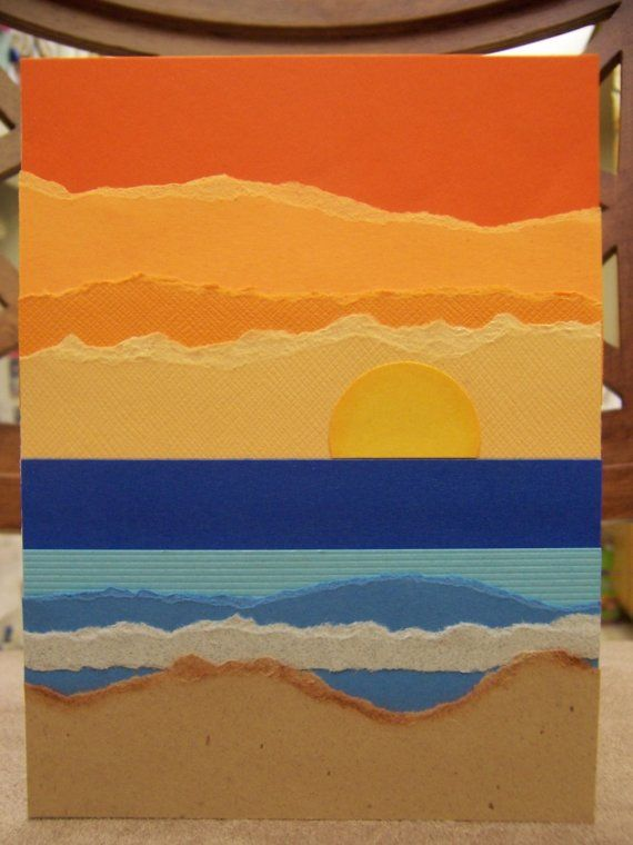 Are you familiar with torn paper art? Thats where you tear different colors of paper to make a scene. Ive done that to make a beach scene at sunset on this card. Picture is pretty self-describing. Sand, water, waves, sun, sunset. Colors brown for the sand, 4 different blues (counting the foam) for the water, 4 different oranges from light to dark for the sunset, and yellow for the sun. The sun is chalked a little bit around the edge, as is the sand. This is really a beautiful, unique card…