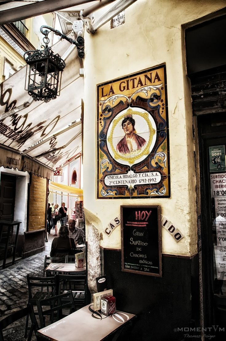 Tapas Bar - Seville, Spain: Not doing to much obvious spanish, but a sign outside made in tile could be cool.