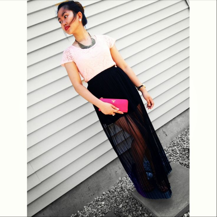 Looking elegant with my long black skirt and prada purse