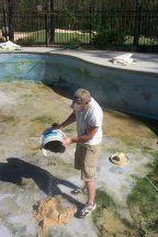 Inground pool liner replacement - adding a mixture of sand and cement.