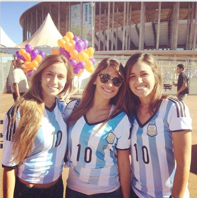 Celebration: Lionel Messi's girlfriend, Antonella Roccuzzo (centre,) poses in a number 10 shirt outside the stadium in Brasilia