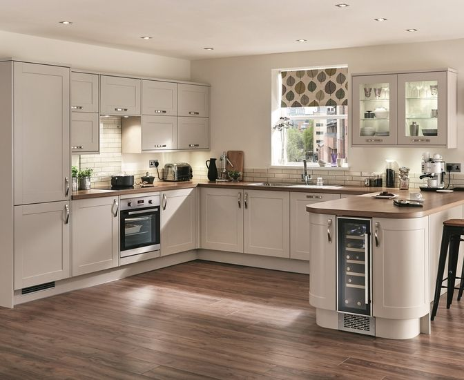 Some nice features in this Burford Cashmere kitchen from Howdens. Like the curved ends and the wine cooler!