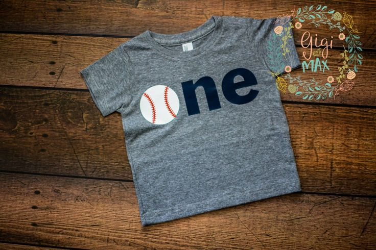 "This listing is for a baby boy first birthday shirt! The ""o"" is a baseball to go with your little ones baseball birthday theme! All letters/numbers are professionally heat pressed onto a short sleeve"