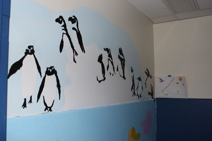 Students created murals for the washroom entrances.