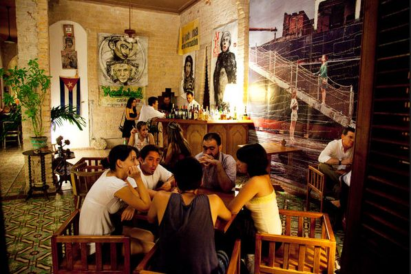 Madrigal ~ the loft-style bar (and home) of the filmmaker Rafael Rosales. There, you can sip head-splittingly cold mojitos and daiquiris (the tapas — cheese empanadas and tomato bruschetta — are forgettable) to a smooth soundtrack of jazz and R&B. #Havana #Bar #Paladar #Madrigal #Vedado