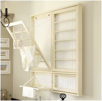 DIY Laundry Room Drying Rack by centsationalgirl: Folds flush when not in use.
