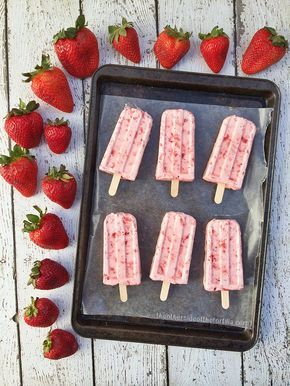 Beautiful paletas de fresas con creme ~ Mexican strawberries and cream popsicles /// #recipe from theothersideofthetortilla.com