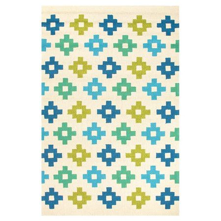 Anchor your dining set or patio seating group with this versatile rug, showcasing a Southwestern-inspired motif.    Product: Rug