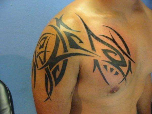 shoulder tribal 30 Marvelous Shoulder Tattoos For Guys