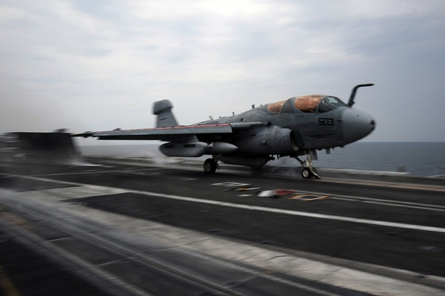 An EA-6B launches from USS Nimitz. by Official U.S. Navy Imagery