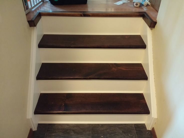 Removed old green carpet, new risers, kept old treads for a more used look, and made a makeshift transition from floor to stairs. Stain, poly, paint.