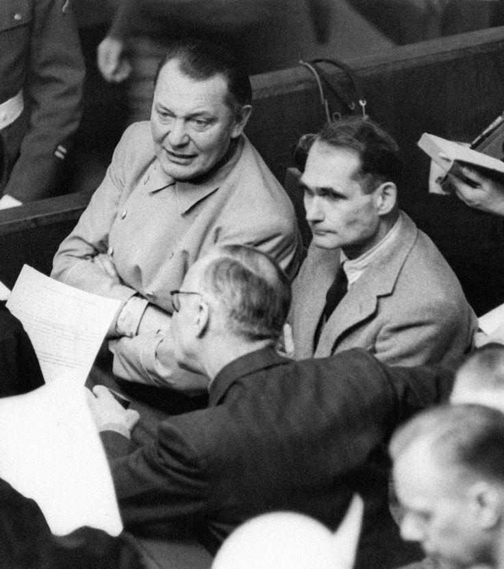 Hermann Göring, Rudolf Hess, and Joachim von Ribbentrop chatting at the Nuremberg trials (1946)