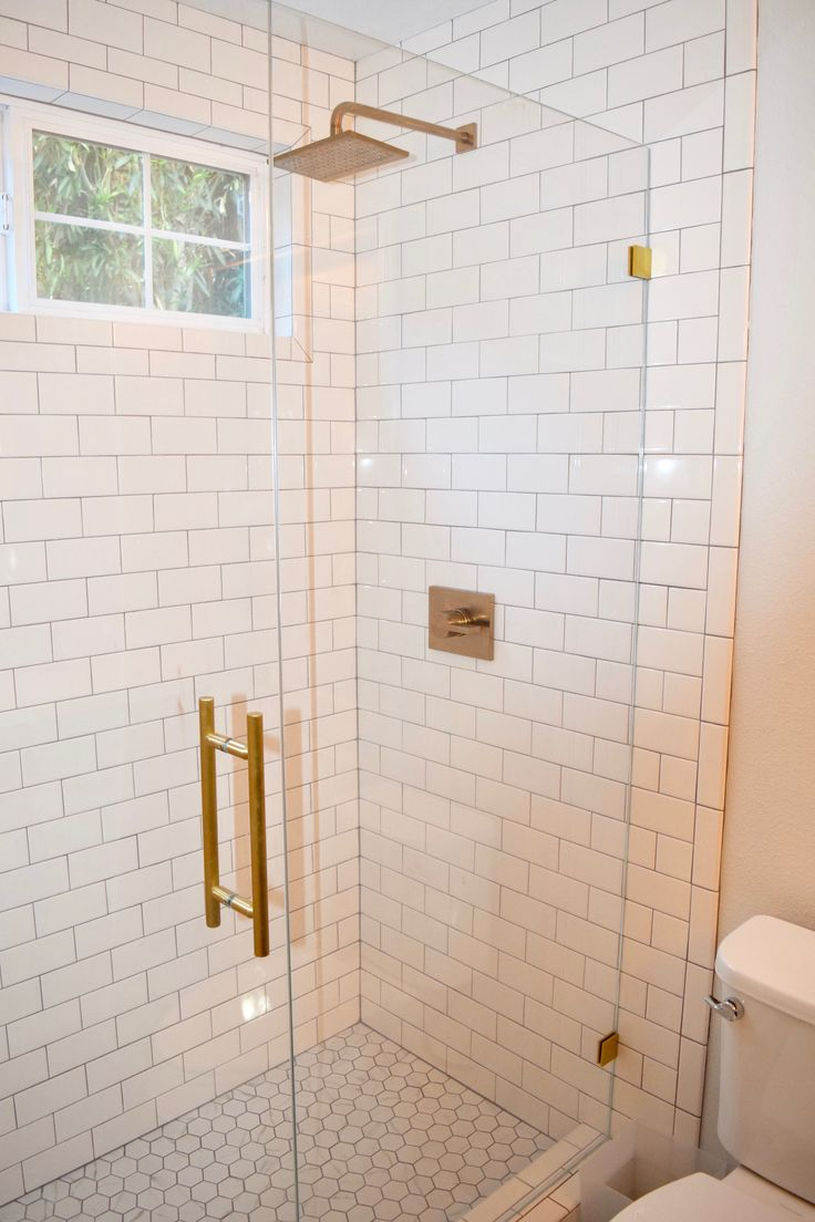 The 25 best white subway tile shower ideas on pinterest white white subway tile shower with brushed gold fixtures doublecrazyfo Image collections