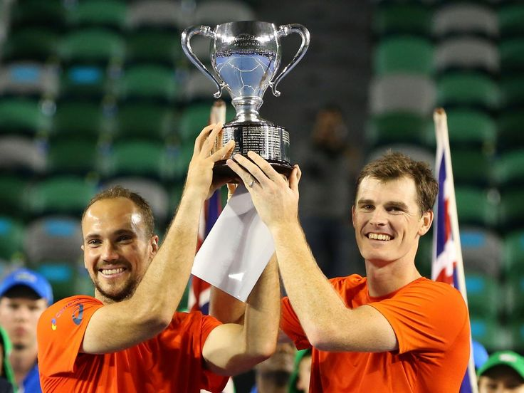 Jamie Murray of Great Britain and Bruno Soares of Brazil pose with the trophy