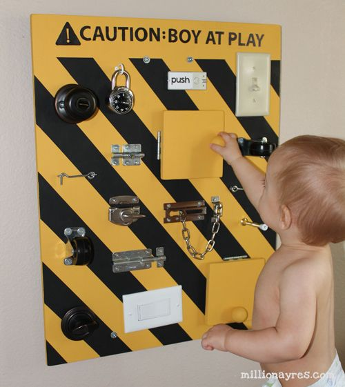 DIY busy board full of switches, latches, and doo-dads for babies and toddlers to manipulate.